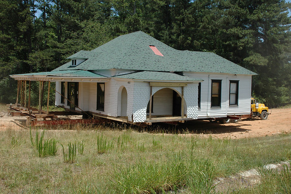 """Wednesday, June 20<br /> MOVIN' THE HOUSE<br /> <br /> Today was the day that the old Hinton house/Blessings Cottage was moved.  This old house was built by a Hinton several generations ago and is still owned by the family.  After only a few glitches, they got the house moved to it's new location a few hundered yards away.  The move drew quite a crowd: Hinton family members, Blessings Cottage owners & friends, and lots of passers-by that just stopped to see what was goin' on.<br /> <br /> We experienced history today in Dacula, GA.<br /> <br /> <br /> <br /> <br /> to see more pictures of the move:<br /> <a href=""""http://moorememories.smugmug.com/gallery/3036221"""">http://moorememories.smugmug.com/gallery/3036221</a><br /> <br /> <br /> """"All changes, even the most longed for, have their melancholy; for what we leave behind us is a part of ourselves; we must die to one life before we can enter another.""""  <br /> ~Anatole France"""