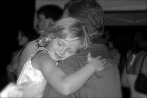 "Saturday, June 16<br /> DANCING WITH DADDY<br /> <br /> At a wedding reception on the eve of Father's Day, what a fitting and sweet shot.  <br /> <br /> ""A truly rich man is one whose children run into his arms when his hands are empty.""<br />   ~Author Unknown"